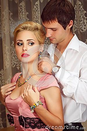 Free Young Man Puts On Jewelry On Beautiful Woman Stock Image - 27289291