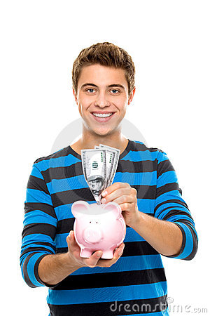 Young man putting money in piggy bank