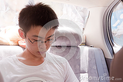 Young man read in car