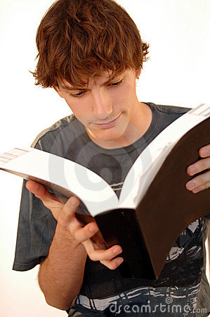 Young man reading big book