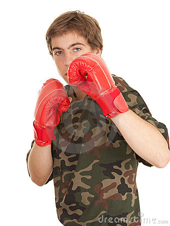 Young man in red boxing gloves