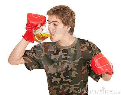 Young man in red boxing gloves with beer