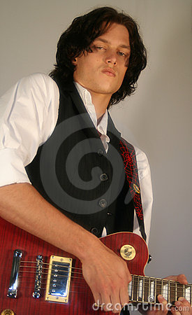 A Young Man with a Red Guitar