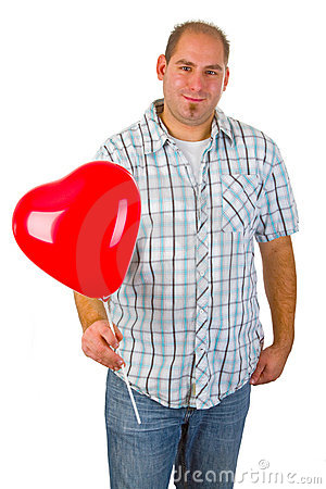 Young man with red heart ballon