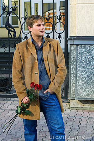Young man with a red roses