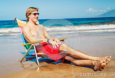 Young Man Relaxing at the Beach