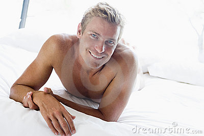 Young man relaxing in bed