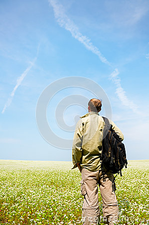 Young man rest on green field