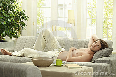 Young man resting on couch