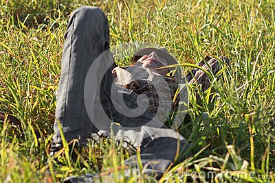 Young man resting in grass outdoors