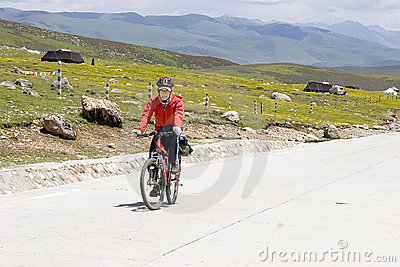 Young man rides bike