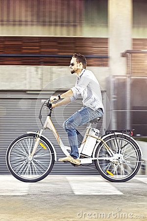 Young man riding electric bicycle