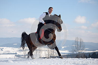 Young man riding horse outdoor