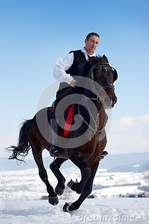 Young man riding horse outdoor