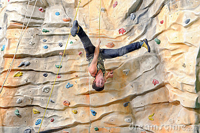 Young man on rock wall