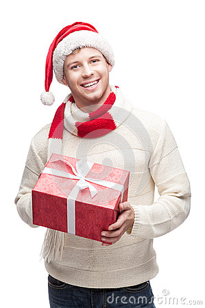 Young man in santa hat holding big red christmas g