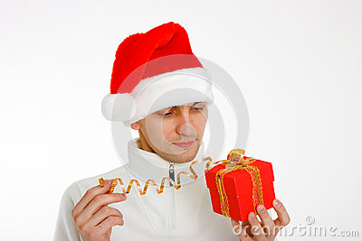 Young man in a Santa hat holding gift