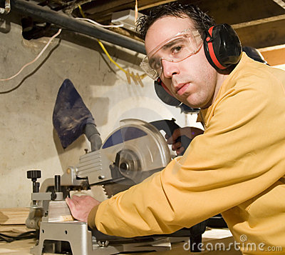 Young Man Sawing Some Wood
