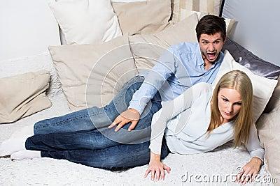 Young man screaming at woman