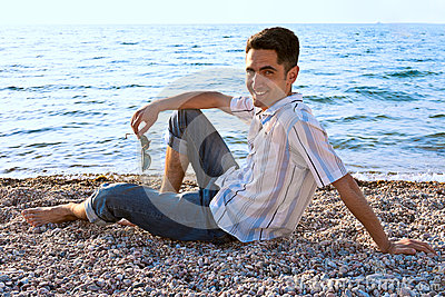 Young man on the sea coast.