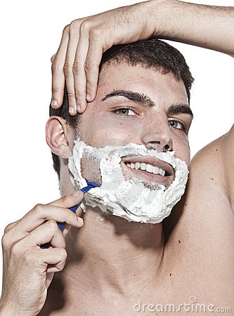 Young man shaving