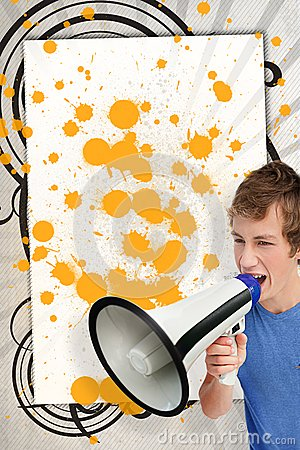 Young man shouting through megaphone in front of copy space with