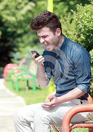 Young man shouting on telephone