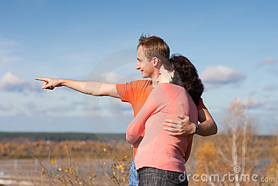Young man shows to his wife their future home