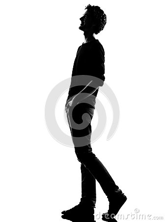Young man silhouette walking  happy laughing