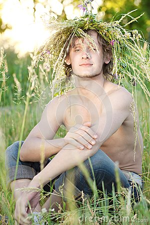 Young man sit on grass