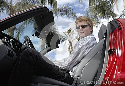 Young Man Sitting In Convertible Car