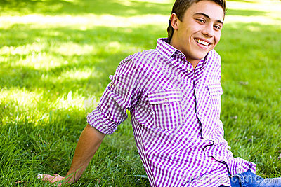 Young man sitting on lawn