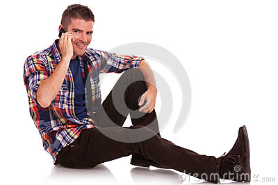 Young man sitting on the phone