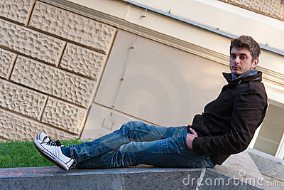 Young man sitting on slope steps