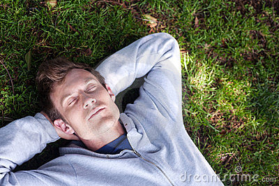 Young man sleeping in the grass