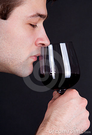 Free Young Man Smelling A Glass Of Red Wine Royalty Free Stock Photography - 18779787