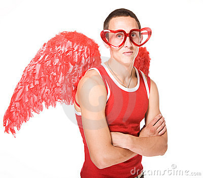 Young man smiles in red heart-glasses with wings o
