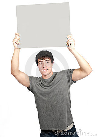 Young man smiling and holding sign