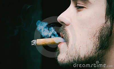 Young man smoking cigar