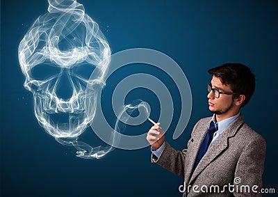 Young man smoking dangerous cigarette with toxic skull smoke