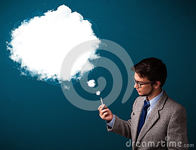 Young man smoking unhealthy cigarette with dense smoke