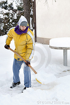Young man with snow shove