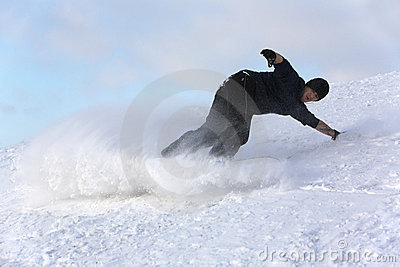 Young man on snowboard