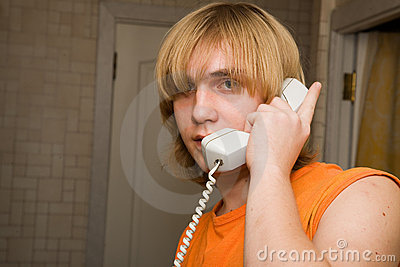 Young man speaking by phone.