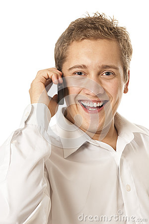 Young man speaks by a mobile phone