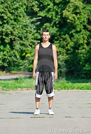 Young man in sports wear in park