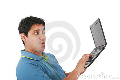 Young man standing, holding a laptop computer