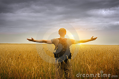 Young man standing on a wheat field
