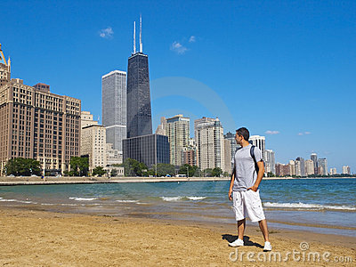 Young man staring at the Chicago Skyline