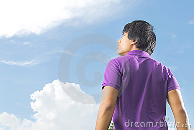 Young man starring at the sky